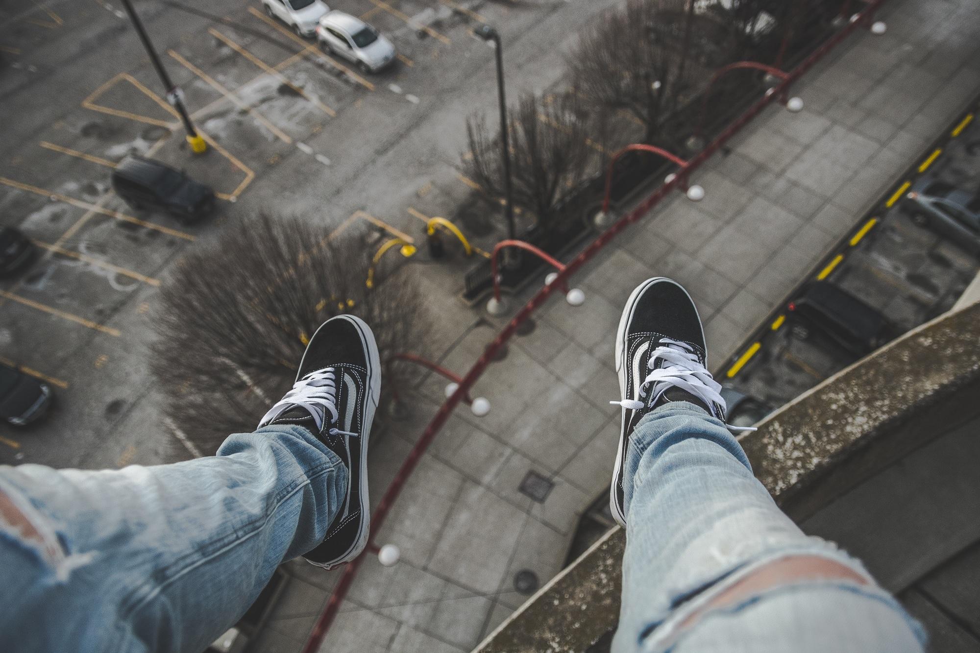 dangling legs city landscape